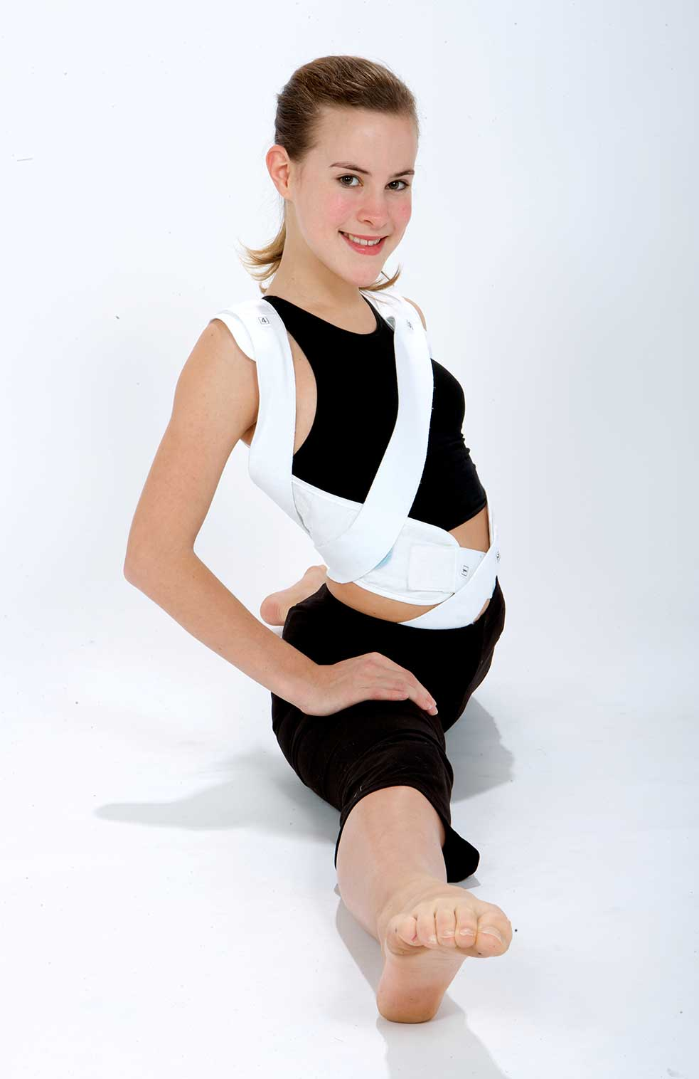 Woman in brace to treat scoliosis